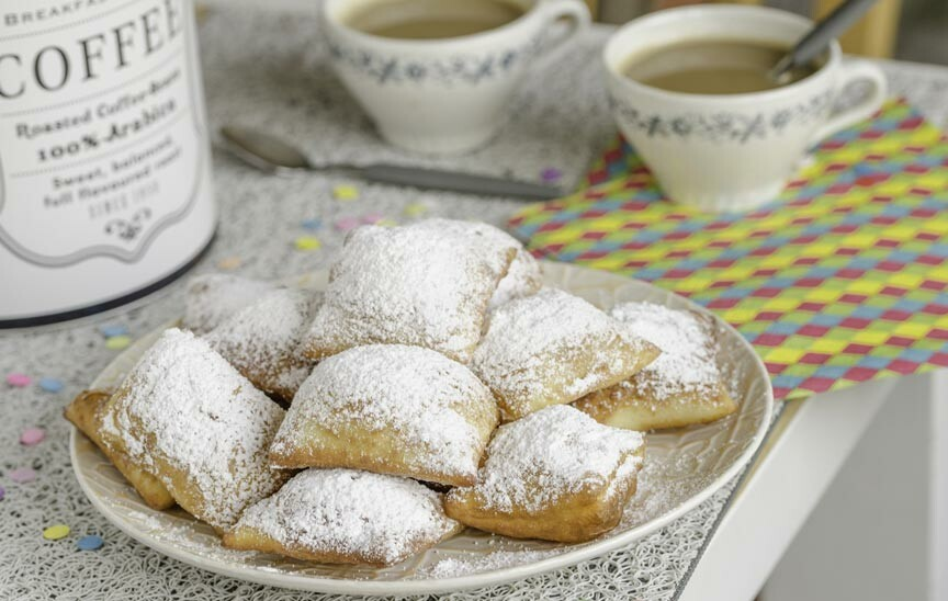 Traditional beignets and cafe au lait for Eureka Gras